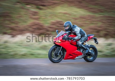 Panning Motorbike At Speed, To Create Motion Blur On A Country Road In  Upper Coquetdale