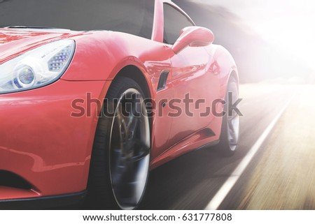 Panning shot of a beautiful red sports car speeding on a highway with motion blur
