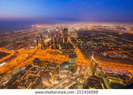 Panoram of night Dubai during sunset - stock photo