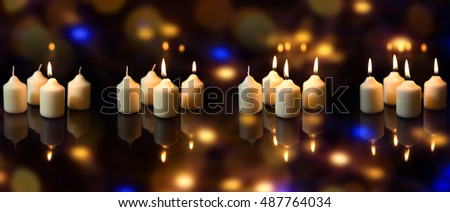 Panorama, advent season with a lot of candles, sparkling reflections, colorful background