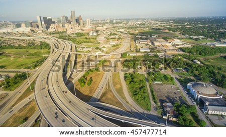 Panorama aerial view Houston downtown and interstate 69 highway with massive intersection, stack interchange and elevated road junction overpass at early morning from the northeast side of Houston, US