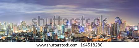 Panorama Aerial view of Bangkok downtown Skyline at night - stock photo