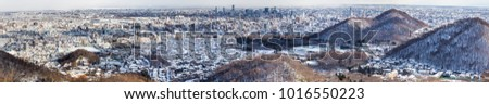 Panorama aerial view of Sapporo city Japan during winter with snow