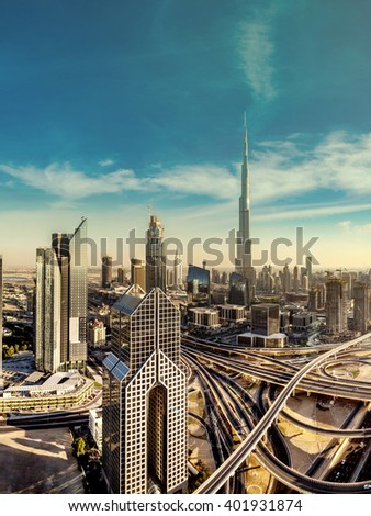 Panorama and aerial view of downtown Dubai in a summer day, United Arab Emirates - stock photo