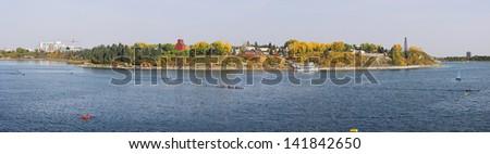 Panorama Autumn view of Heritage Park & Glenmore Reservoir, Calgary, Alberta, Canada. - stock photo