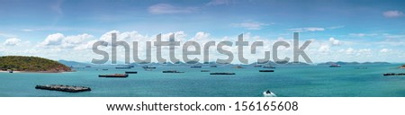 panorama cargo ship in sea.Cargo ships parked in the lot near the sea Island on Clear Cloud. - stock photo