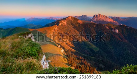 Panorama. Cuesta Achishboki and mountain Asbestnaya the last rays of the sun, summer mountain landscape. - stock photo