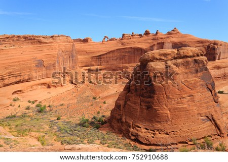 Panorama from Utah. Famous delicate arch. Red rocks canyon, geological formations. United States of America