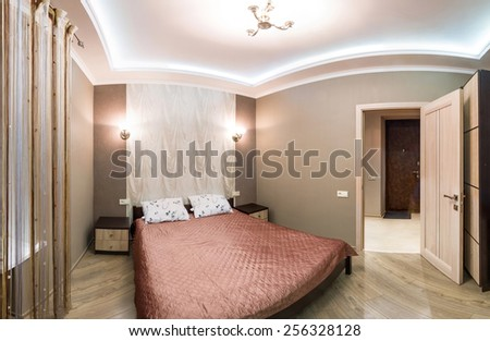 Panorama hotel room. Small bedroom with double bed. Modern interior room - stock photo