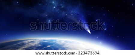 Panorama illustration of a blue Earth like alien planet in space with a comet - stock photo