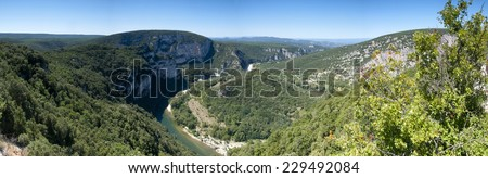 Panorama image of a bend in the famous river of the Ardeche gorge - stock photo