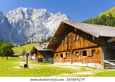 panorama landscape in Bavaria, germany, at alps mountains with wooden farm house - stock photo