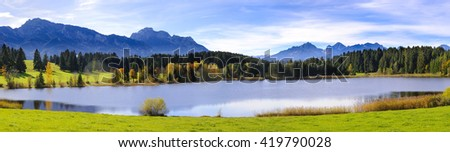 Panorama landscape in Bavaria with beautiful lake and alps mountains - stock photo