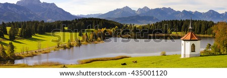panorama landscape in Bavaria with lake and mountains - stock photo