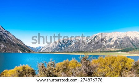 Panorama Landscape of mountain range at Lake Pearson Arthur's pass National Park New Zealand  - stock photo