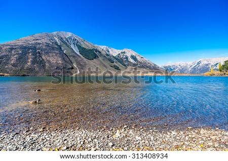 Panorama Landscape of mountain range at Lake Pearson Arthur's pass National Park New Zealand  - stock photo