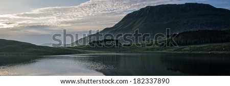 Panorama landscape stunning sunrise over lake in mountain range - stock photo