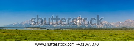 Panorama landscape - The amazing Teton mountains above Jackson Lake in Wyoming, USA. - stock photo