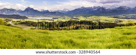 panorama landscape with lake and alps mountains in Bavaria, Germany - stock photo