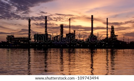 PANORAMA lonely, Sunrise, oil refinery factory with reflection on the river. - stock photo