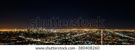 Panorama long exposure night view of Los Angeles downtown and surrounding metropolitan area at night - stock photo