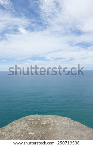 Panorama lookout over ocean at Bass Strait, Tasmania, Australia, at edge of rock platform, view to horizon and copy space. - stock photo