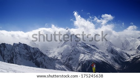 Panorama Mountains at nice day. Ski slope with skier. Caucasus Mountains, Dombay.  - stock photo