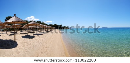 Panorama of a beach and turquoise water at the luxury hotel, Halkidiki, Greece - stock photo
