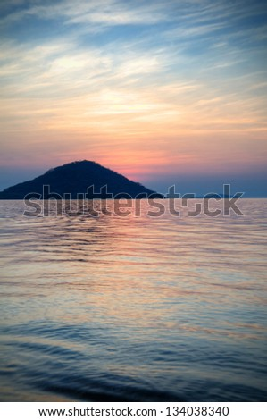 Panorama of a beach in Monkey Bay in dusk, Lake Malawi, Malawi, Africa - stock photo