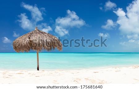 Panorama of a beautiful tropical beach and Caribbean sea - stock photo