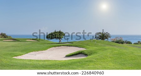 Panorama of a golf course on a sea background. Summer for tourists.
