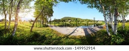 Panorama of a morning pond and gravel walkway. Seefeld, Austria - stock photo