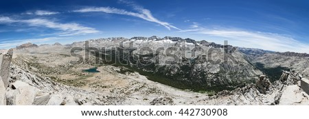 panorama of a mountain valley from Pilot Knob looking over the Humphreys Basin and Glacier Divide in the Sierra Nevada Mountains - stock photo