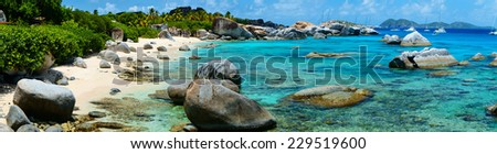 Panorama of a picture perfect beach with white sand, turquoise ocean water and blue sky at British Virgin Islands in Caribbean - stock photo