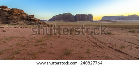 Panorama of a Sunset in Wadi Rum desert, Jordan - stock photo