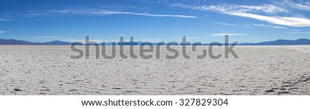 Panorama of a the Salinas Grande against a blue sky, a huge salt field in Jujuy Province, north of Argentina.
