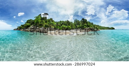 Panorama of a tropical island surrounded by clear turquoise sea. Phuket island, Thailand - stock photo