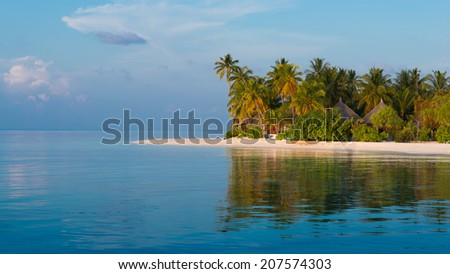 Panorama of a tropical island with a white sand beach and turquoise water of the ocean. Landscape  with palm trees.