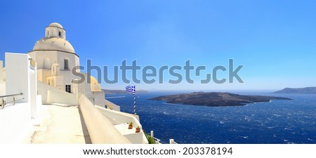 Panorama of a volcanic caldera and Agios Mina church (St. Minas) in Fira, Santorini (Thira), Cyclades islands, Greece - stock photo