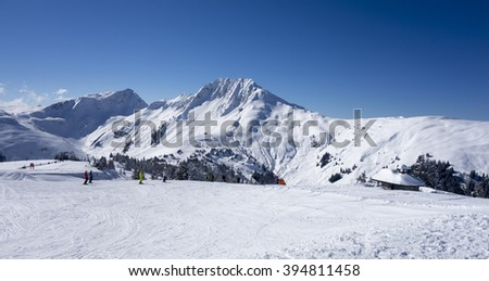 Panorama of a winter landscape at a ski area with skiers, Kitzski, Kitzbuhel - Kirchberg, Austria