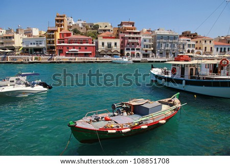 Panorama of Aghios Nikolaos(Crete, Greece). Agios Nikolaos is probably best known as a tourist town that serves as hub to the twenty or so small villages and farms that make up that part of Lassithi. - stock photo