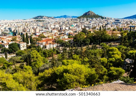 Panorama of Athenes, Greece with houses and Lycabettus Hill against blue sky