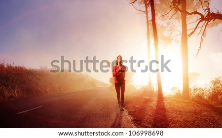 Panorama of athlete running outdoors on a road training and exercising for a marathon endurance sport.  XXXL - stock photo