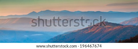 Panorama of autumn mountains in the morning mist - stock photo