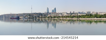 Panorama of Baku downtown with Flame Towers skyscrapers and TV tower from Caspian Sea, Azerbaijan - stock photo
