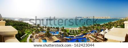 Panorama of beach with a view on Jumeirah Palm man-made island, Dubai, UAE - stock photo