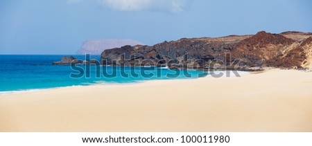 Panorama of beautiful beach and tropical sea of Lanzarote. Canaries - stock photo