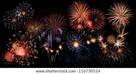 Panorama of beautiful colorful holiday fireworks on the black sky background,  long exposure - stock photo