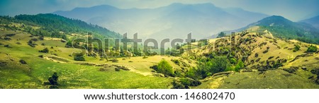 Panorama of Beautiful Mountain Valley with Sunlight - stock photo