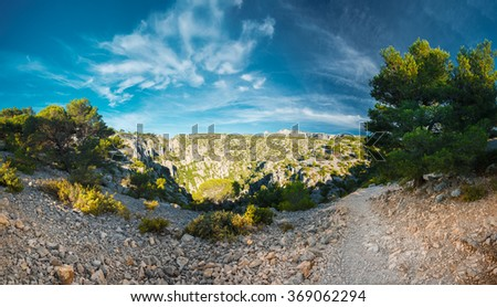 Panorama of beautiful nature of Calanques on the azure coast of France. High cliffs under blue sunny sky. - stock photo